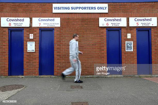 A supporter maks his way to the stadium during the Sky Bet League Two match between Tranmere Rovers and Carlisle United at Prenton Park on February 7...