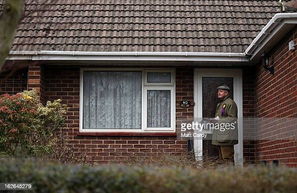 Supporter Neil Hamilton knocks on doors in a street as he helps campaign for UKIP in the forthcoming by-election on February 25, 2013 in Eastleigh,...
