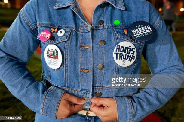 Supporter Nelly Tobon wears pins during a campaign rally for Democratic presidential candidate Massachusetts Senator Elizabeth Warren on the eve of...
