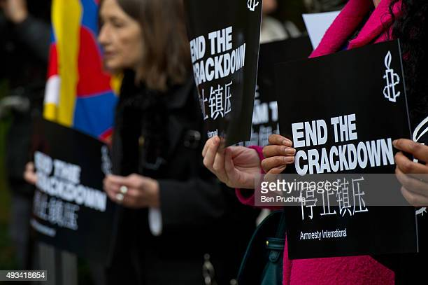 A supporter of Amnesty International holds a sign with the slogan 'end the crackdown' in protest against claims of a deterioration in human rights...