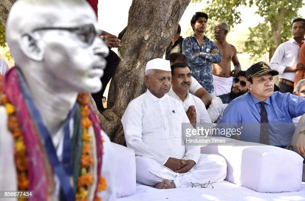 A supporter of Anna Hazare impersonates the 'Father of the Nation' Mahatma Ganadhi with social activist Anna Hazare during a daylong hunger strike...