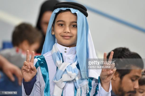 A supporter of Argentina gestures ahead of the friendly football match between Brazil and Argentina at the King Saud University stadium in the Saudi...
