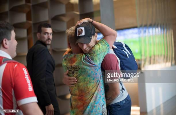 A supporter of Argentina's team Independiente greets footballer Fernando Amorebieta in the lobby of the Hilton Barra hotel in Rio de Janeiro Brazil...