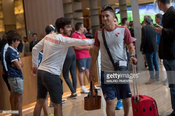 A supporter of Argentina's team Independiente greets footballer Leandro Miguel Fernandez in the lobby of the Hilton Barra hotel in Rio de Janeiro...