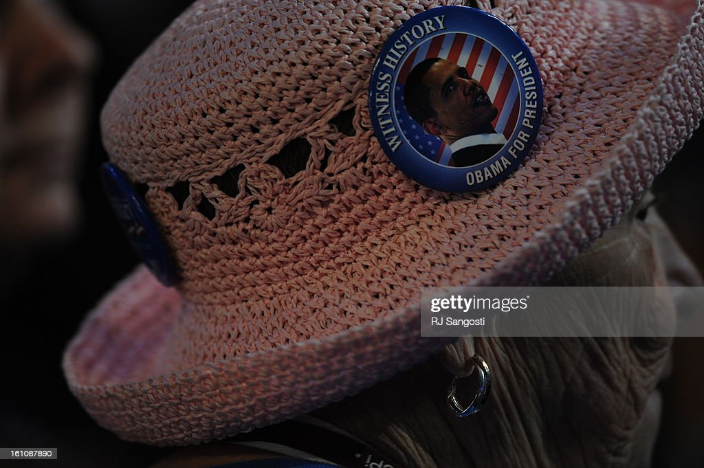 6fdfaa53e7 A supporter of Barack Obama sports a pin on her mesh hat while on the floor