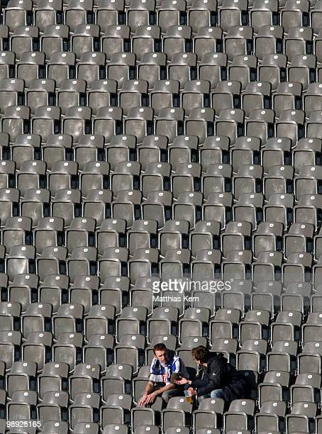 Supporter of Berlin sit at the tribune after the Bundesliga match between Hertha BSC Berlin and FC Bayern Muenchen at Olympic Stadium on May 8 2010...