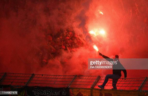 A supporter of Berlin's lights a firework during the German second division Bundesliga football match VfL Bochum v Union Berlin in Bochum western...