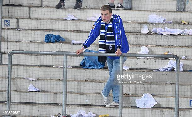 A supporter of Bielefeld looks dejected in the main stand after the Second Bundesliga Playoff Second Leg match between Arminia Bielefeld and...