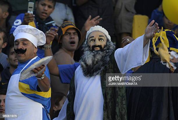 A supporter of Boca Juniors' dressed up as AlQaeda chief Osama Bin Laden holds a plastic chicken before the start of the Argentina's first division...
