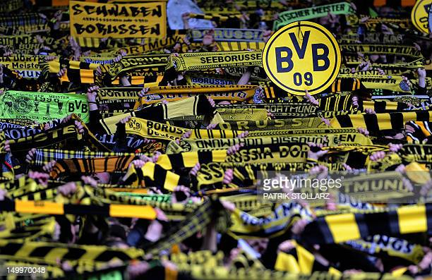 Supporter of Borussia Dortmund hold up fan shawl prior to the German first division Bundesliga football match Borussia Dortmund vs Borussia...