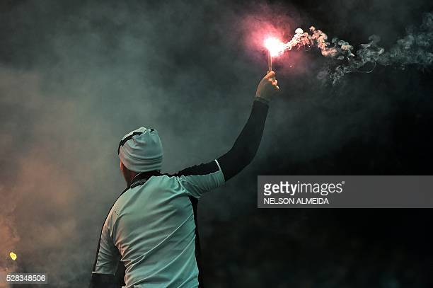 A supporter of Brazilian Corinthians cheers for his team during the 2016 Copa Libertadores football match against Uruguay's Nacional held at Arena...