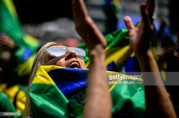 A supporter of Brazilian farright presidential candidate Jair Bolsonaro takes part in a rally in Rio de Janeiro Brazil on October 21 2018 Barring any...