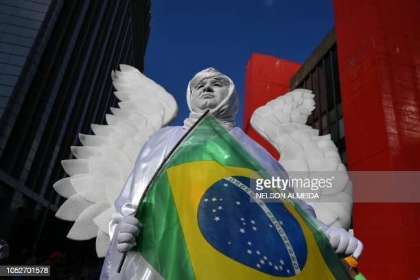 A supporter of Brazilian farright presidential candidate Jair Bolsonaro takes part in a rally in Sao Paulo Brazil on October 21 2018 Barring any...