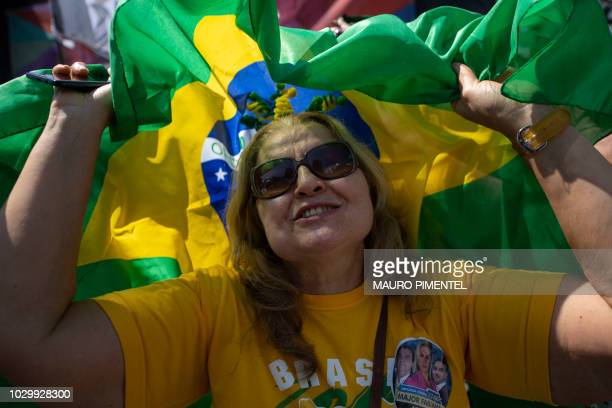 A supporter of Brazilian rightwing presidential candidate Jair Bolsonaro attends a rally at Copacabana beach in Rio de Janeiro Brazil on September 09...