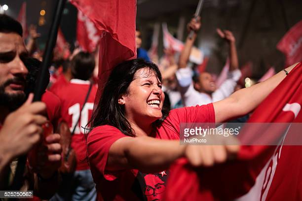 A supporter of Brazil's President Dilma Rousseff who is presidential candidate for the Workers Party celebrates after the result of the elections...