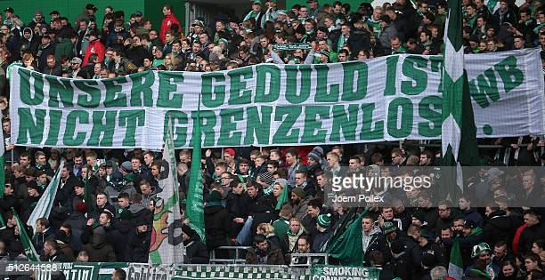 Supporter of Bremen display a banner before the Bundesliga match between Werder Bremen and SV Darmstadt 98 at Weserstadion on February 27 2016 in...