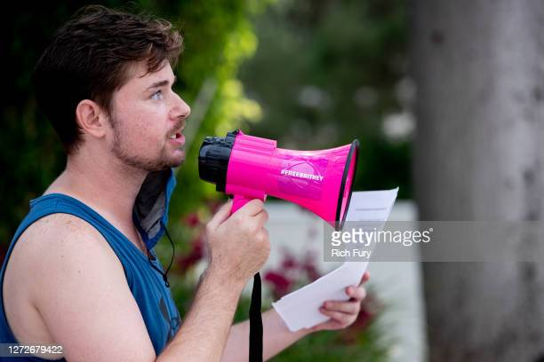 A supporter of Britney Spears holds a sign and speaks during a #FreeBritney protest outside of the Tri Star Sports Entertainment Group offices on...