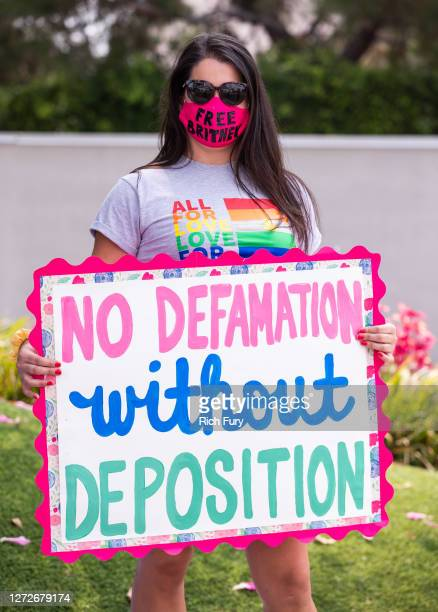 A supporter of Britney Spears holds a sign during a #FreeBritney protest outside of the Tri Star Sports Entertainment Group offices on September 15...
