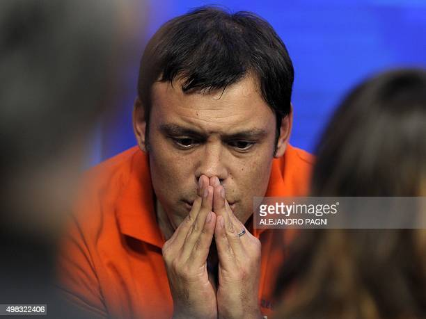 A supporter of Buenos Aires province governor and presidential candidate for the Frente Para la Victoria Daniel Scioli reacts in dejection after...