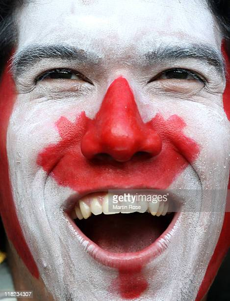 A supporter of Canada cheers before the FIFA Women's World Cup 2011 Group A match between Canada and Nigeria at RudolfHarbigStadion on July 5 2011 in...