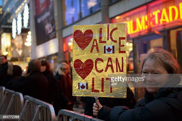 A supporter of Canadian writer Alice Munro holds up a poster prior to the Nobel Prize award ceremonies for Medicine Physics Chemistry Literature and...