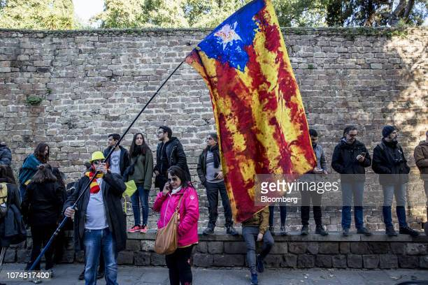A supporter of Catalan independence holds a Catalan estelada flag during a protest on Paralelo Avenue in Barcelona Spain on Friday Dec 21 2018...
