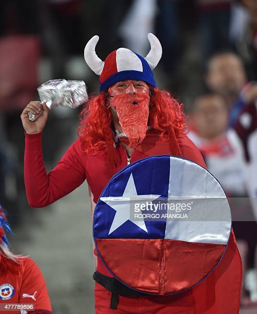 A supporter of Chile waits for the start of the 2015 Copa America football championship match between Chile and Bolivia in Santiago on June 19 2015...
