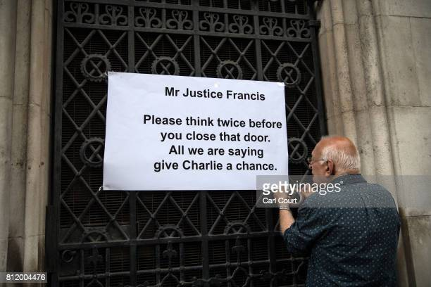 A supporter of Chris Gard and Connie Yates the parents of terminally ill toddler Charlie Gard take part in a demonstration outside the High Court as...