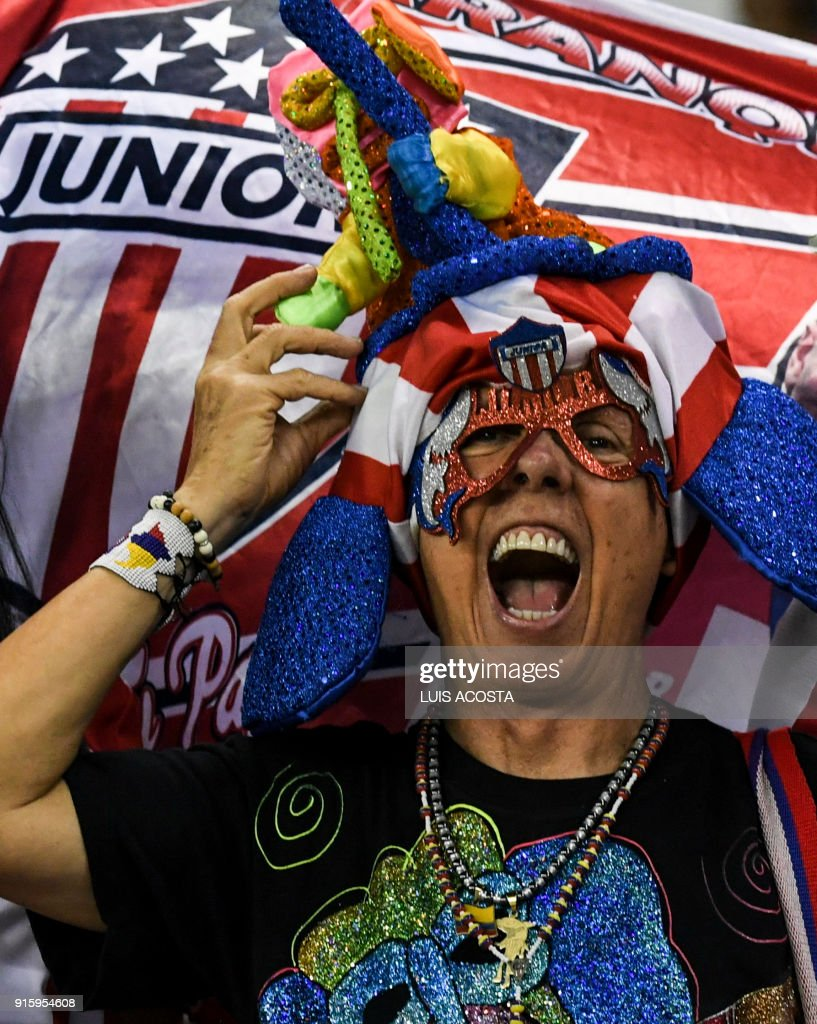 A supporter of Colombia's Junior cheers for her team before a Copa Libertadores football match against Paraguay's Olimpia at Roberto Melendez stadium in Barranquilla, Colombia, on February 8, 2018. / AFP PHOTO / Luis ACOSTA