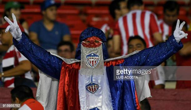 A supporter of Colombia's Junior cheers for his team before a Copa Libertadores football match against Paraguay's Olimpia at Roberto Melendez stadium...