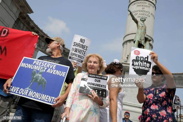 A supporter of conserving Confederate monuments Helen Marie Taylor stands among counter protesters as they rally at the Jefferson Davis Monument...