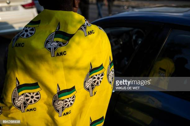 A supporter of Cyril Ramaphosa South African Vice President and presidential hopeful of the African National Congress is wrapped in an ANC flag...