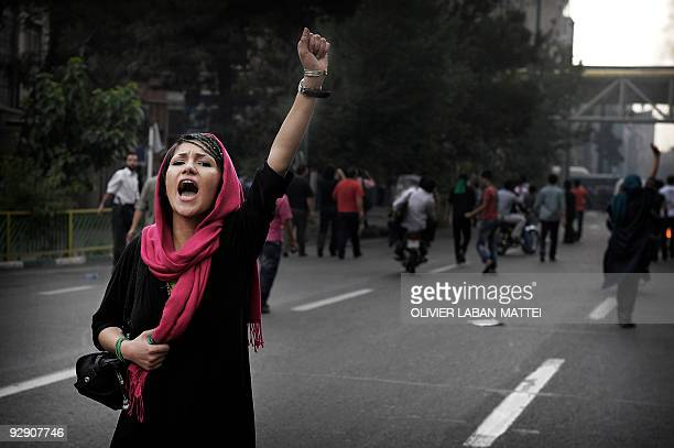 A supporter of defeated Iranian presidential candidate Mir Hossein Mousavi shouts slogans during riots in Tehran on June 13 2009 Hardline incumbent...