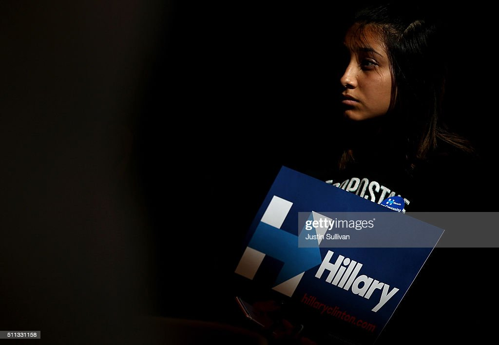 A supporter of Democratic presidential candidate former Secretary of State Hillary Clinton holds a campaign sign during a Women and Familes Round Table event at the College of Southern Nevada on February 19, 2016 in North Las Vegas, Nevada. With one day to go before the Democratic caucuses in Nevada, Hillary Clinton is campaigning in Las Vegas.