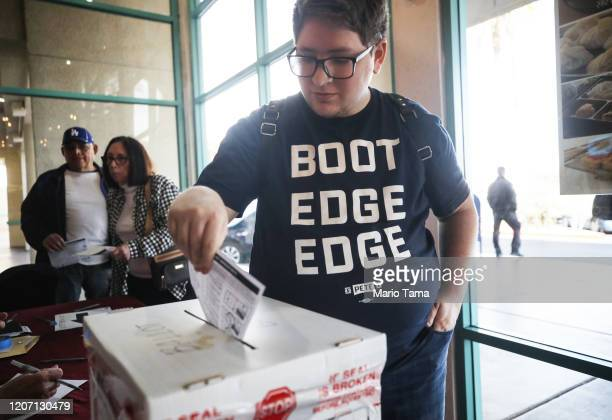 A supporter of Democratic presidential candidate former South Bend Indiana Mayor Pete Buttigieg casts a ballot on the final day of early voting for...