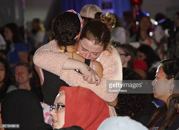 A supporter of Democratic presidential candidate Hillary Clinton cries as US media reports Republican Donald Trump is leading in the election at...
