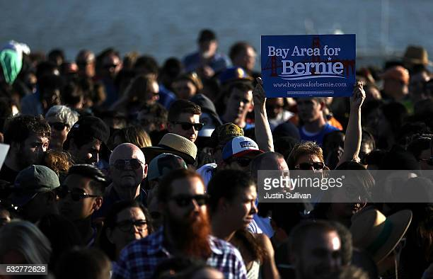 A supporter of democratic presidential candidate Sen Bernie Sanders holds a sign during a campaign rally at Waterfront Park on May 18 2016 in Vallejo...
