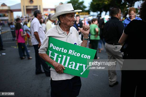 A supporter of democratic presidential hopeful US Sen Hillary Clinton holds a sign as he waits for a rally to begin at the Plaza de la Darsena May 30...