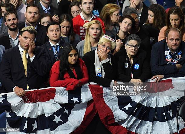 Supporter of Democratic presidential nominee Hillary Clinton react to television reports during election night at the Jacob K. Javits Convention...
