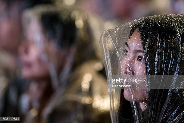 A supporter of Democratic Progressive Party presidential candidate Tsai Ingwen attends during a rally campaign ahead of the Taiwanese presidential...