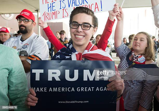 Supporter of Donald Trump holds up a sign during a Trump rally at the International Exposition Center March 12, 2016 in Cleveland, Ohio. Donald Trump...