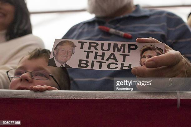 A supporter of Donald Trump president and chief executive of Trump Organization Inc and 2016 Republican presidential candidate holds a sign while...