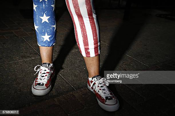 A supporter of Donald Trump presumptive 2016 Republican presidential nominee wears American flag themed pants and shoes outside the Quicken Loans...