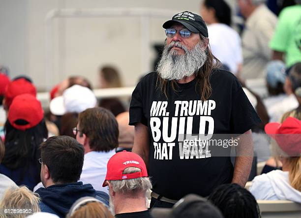 A supporter of Donald Trump waits to hear the Republican presidential nominee speak at a campaign rally at the Henderson Pavilion on October 5 2016...