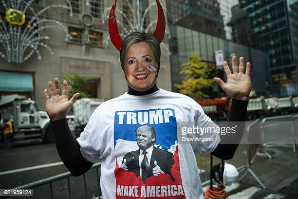A supporter of Donald Trump wears a Hillary Clinton mask outside of Trump Tower November 9 2016 in New York City Republican candidate Donald Trump...