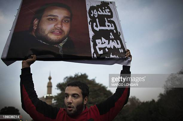 A supporter of Egypt's AlAhly football club holds up a portrait of a fellow ultra during a demonstration in Cairo on February 15 2012 to demand...