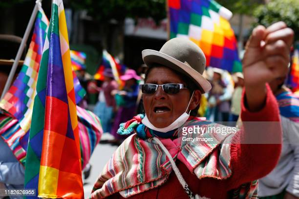 A supporter of Evo Morales shouts slogans during protests on November 15 2019 in La Paz Bolivia Morales flew to Mexico alleging a coup under military...