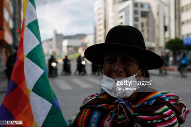 A supporter of Evo Morals member of an indigenous community cries during a protest on November 15 2019 in La Paz Bolivia Morales flew to Mexico...