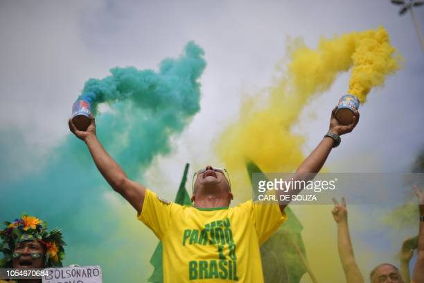 Supporter of far-right lawmaker and presidential candidate for the Social Liberal Party , Jair Bolsonaro, takes part in a pro-Bolsonaro demonstration...