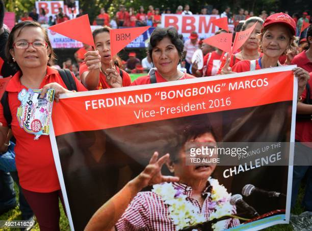 Supporter of Ferdinand Marcos Jr the son of the late Philipine dictator Ferdinand Marcos look on as he announces his vicepresidential bid at a...